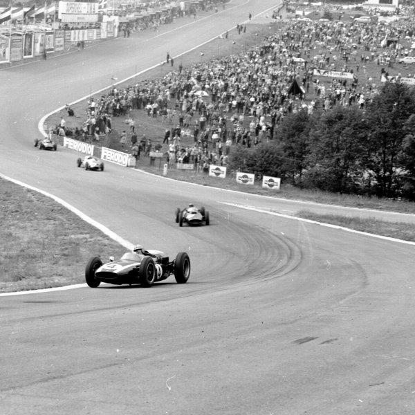 1960 Belgian Grand Prix.Spa-Francorchamps, Belgium.17-19 June 1960.Bruce McLaren (Cooper T53 Climax) leads through Eau Rouge.Ref-6617.World Copyright - LAT Photographic