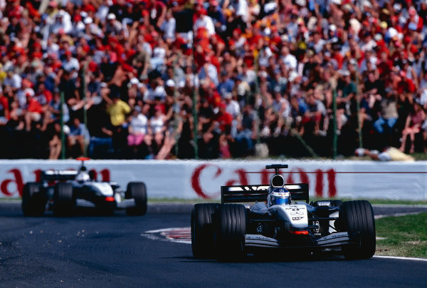 2002 Hungarian Grand Prix.Hungaroring, Budapest, Hungary. 16-18 August 2002.Kimi Raikkonen with David Coulthard (both McLaren MP4/17 Mercedes) behind. They finished in 4th and 5th positions respectively.Ref-02 HUN 15.World Copyright - Rose/LAT Photographic
