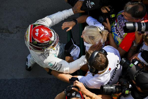 Lewis Hamilton, Mercedes AMG F1, 1st position, celebrates in Parc Ferme with Angela Cullen