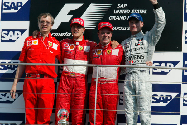 2002 American Grand Prix.Indianapolis, Indiana, USA. 27-29 September 2002.Paolo Martinelli, Michael Schumacher (Ferrari) 2nd position, Rubens Barrichello (Ferrari) 1st position and David Coulthard (McLaren Mercedes) 3rd position on the podium.World Copyright - LAT Photographicref: Digital File Only