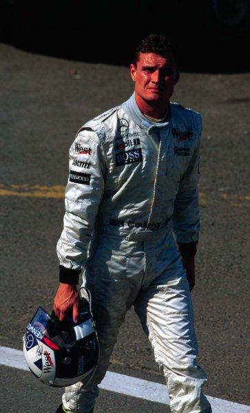 1997 Hungarian Grand Prix.Hungaroring, Budapest, Hungary.8-10 August 1997.David Coulthard (McLaren Mercedes-Benz) retires.World Copyright - Tee/LAT Photographic