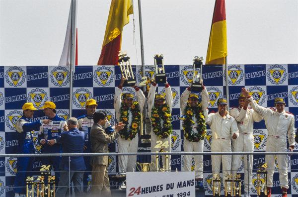 L to R: Jeff Krosnoff, Eddie Irvine, Mauro Martini / Jeff Krosnoff, Hurley Haywood, Mauro Baldi, Yannick Dalmas, Danny Sullivan, Hans-Joachim Stuck Jr and Thierry Boutsen, celebrate on the podium.