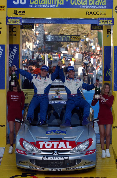 2002 World Rally ChampionshipRally Catalunya, 21st-24th March 2002.Gilles and Herve Panizzi celebrate victory on the podium.Photo: Ralph Hardwick/LAT