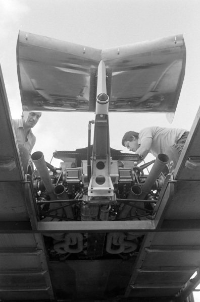 Exhaust detail of a Ferrari 312T2 being unloaded from a team truck.