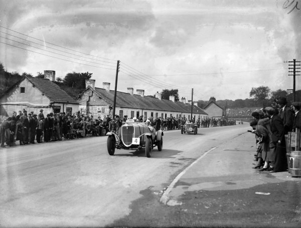 W. T. McCalla, Ford, leads George Eyston, MG Magnette.