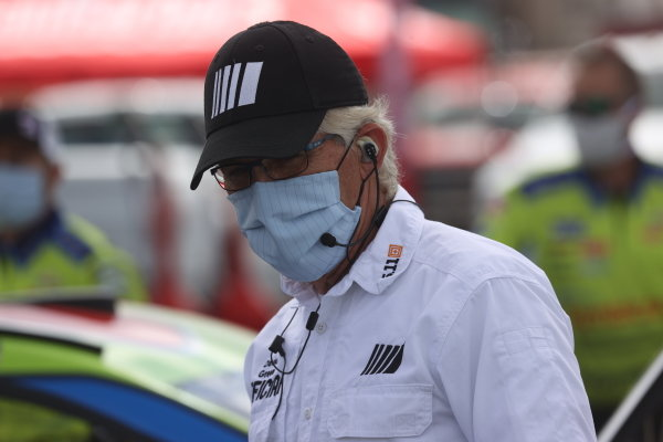 A NASCAR official with a mask Copyright: Chris Graythen/Getty Images.