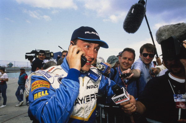 Greg Moore on the phone while being interviewed.
