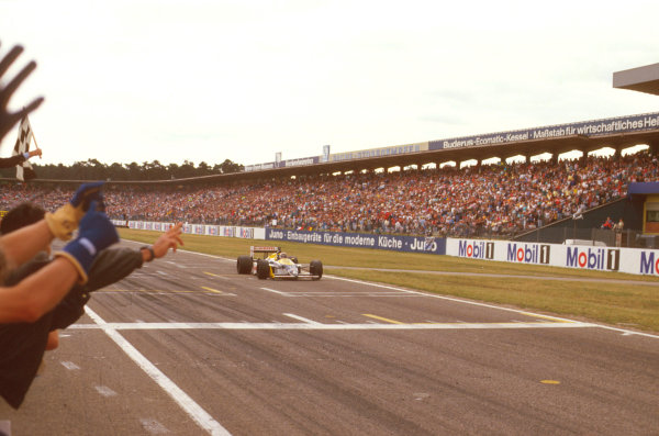 Hockenheim, Germany.24-26 July 1987.Nelson Piquet (Williams FW11B Honda) crosses the line for victory.Ref-87 GER 10.World Copyright - LAT Photographic