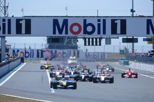 2004 French Grand PrixMagny-Cours, France. 2nd - 4th JulyFernando Alonso, Renault R24 leads the field down to the first corner on the opening lap. Action. World Copyright: LAT PhotographicRef:35mm Image A11