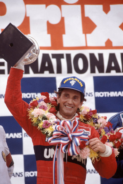 1982 United States Grand Prix East.Detroit, Michigan, USA. 4-6 June 1982. John Watson (McLaren Ford) 1st position on the podium. World Copyright - LAT PhotographicRef-82 USA 16. 60mb Scan.