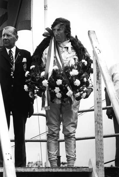 Zandvoort, Holland.19-21 June 1970.Jochen Rindt (Lotus 72C-Ford) 1st position, upset on the podium due to the death of Piers Courage, portrait.World Copyright: LAT Photographic.Ref:  3156 - 37.