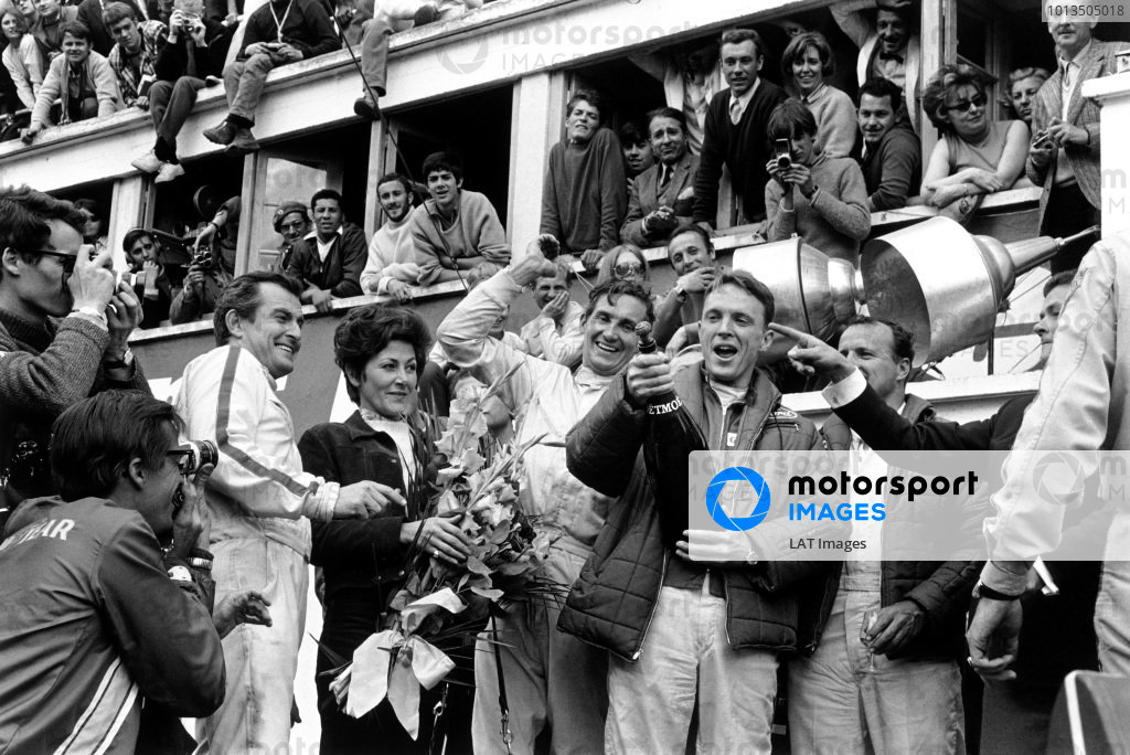 Le Mans, France. 10 - 11 June 1967.Dan Gurney and AJ Foyt (Ford GT40 Mk IV), celebrate finishing in 1st position with Ludovico Scarfiotti and Mike Parks (Ferrari 330 P4 Coupe), 2nd position, and Jean Marie Dubois of Moet (pointing). This was the first time champagne was sprayed in celebration on a podium at Le Mans, portrait. World Copyright: LAT Photographic.