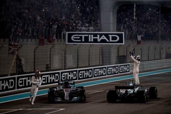 Yas Marina Circuit, Abu Dhabi, United Arab Emirates. Sunday 26 November 2017. Lewis Hamilton, Mercedes AMG, 2nd Position, and Valtteri Bottas, Mercedes AMG, 1st Position, celebrate at the end of the race. World Copyright: Glenn Dunbar/LAT Images  ref: Digital Image _31I9229