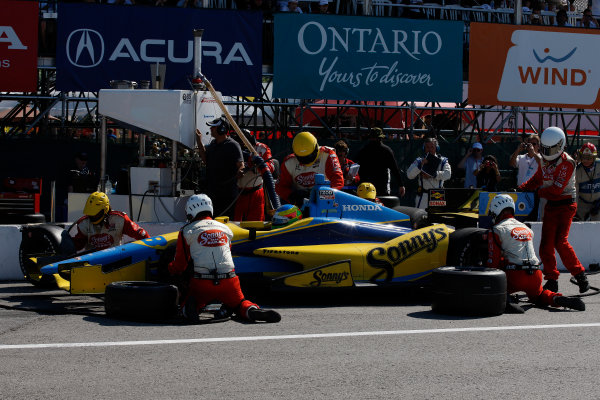 14 July, 2013, Toronto, Ontario, Canada Mike Conway pit stop © 2013, Michael L. Levitt LAT Photo USA.