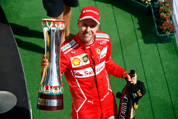 Hungaroring, Budapest, Hungary.  Sunday 30 July 2017. Sebastian Vettel, Ferrari, 1st Position, celebrates on the podium with his trophy. World Copyright: Andrew Hone/LAT Images  ref: Digital Image _ONZ1201