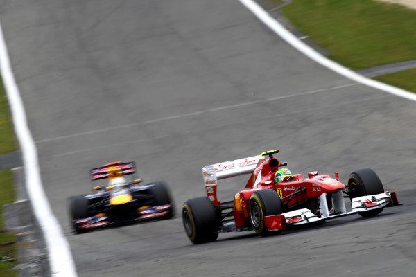 Nurburgring, Germany.24th July 2011Felipe Massa, Ferrari 150° Italia, 5th position, leads Sebastian Vettel, Red Bull Racing RB7 Renault, 4th position. Action. World Copyright: Andy Hone/LAT Photographicref: Digital Image CSP13212