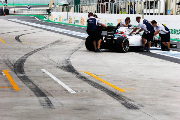 Interlagos, Sao Paulo, Brazil. Saturday 8 November 2014. The Williams team recover the car of Felipe Massa, Williams FW36 Mercedes, to the garage. World Copyright: Steven Tee/LAT Photographic. ref: Digital Image _L4R1379