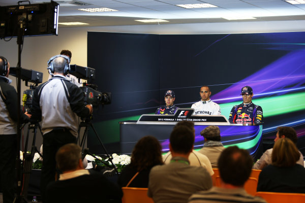 Spa-Francorchamps, Spa, Belgium. 24th August 2013. Lewis Hamilton, Mercedes AMG, Sebastian Vettel, Red Bull Racing, and Mark Webber, Red Bull Racing, in the post qualifying Press Conference. World Copyright: Sam Bloxham/LAT Photographic. ref: Digital Image BH2I0357.