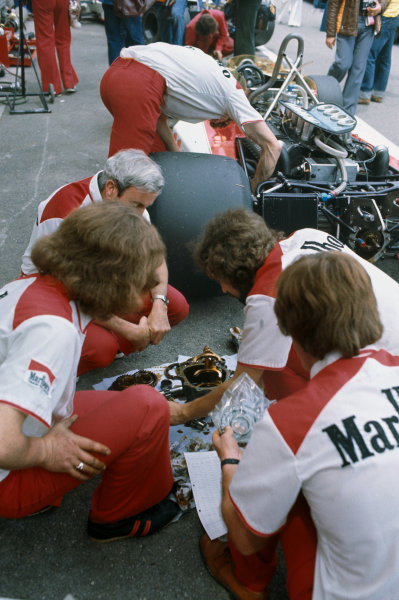 Monte Carlo, Monaco. 27th - 30th May 1976. The McLaren mechanics work on James Hunt's car in the pit lane, portrait.  World Copyright: LAT Photographic.  Ref: 76 MON 64.