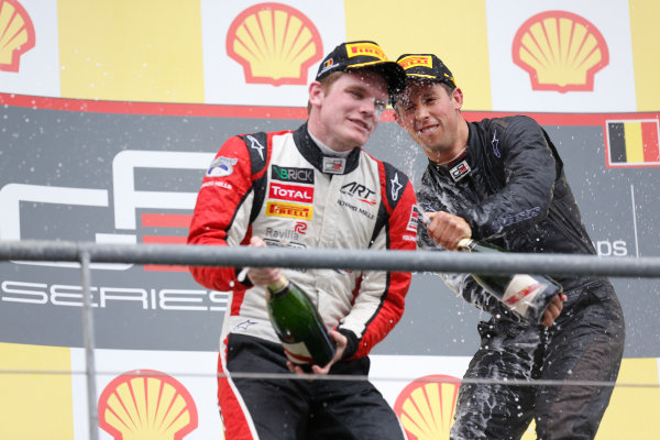 2013 GP3 Series. Round 6.  Spa - Francorchamps, Spa, Belgium. 25th August. Sunday Race. Alexander Sims (GBR, Carlin) celebrates his victory on the podium with Conor Daly (USA, ART Grand Prix). World Copyright: Alastair Staley/GP3 Media Service. ref: Digital Image _R6T8354.jpg