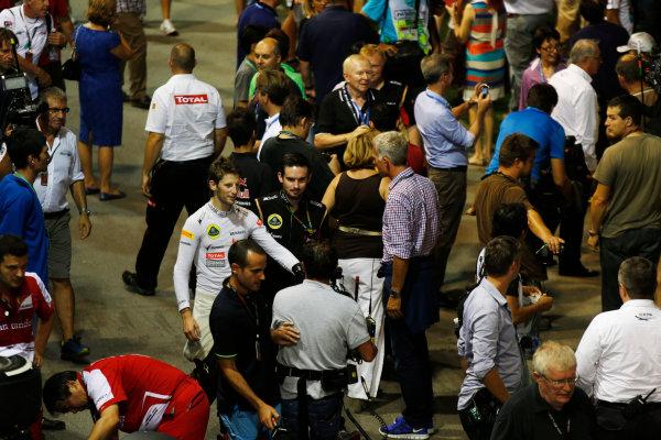 Marina Bay Circuit, Singapore. Saturday 21st September 2013. Romain Grosjean, Lotus F1 walks in the paddock. World Copyright: Charles Coates/LAT Photographic. ref: Digital Image _N7T5506
