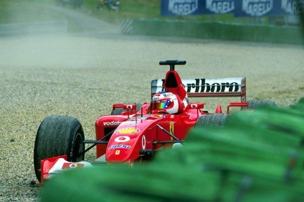 Rubens Barrichello (BRA) takes his Ferrari F2002 into the A1-Ring gravel trap. Austrian Grand Prix, Rd6, A1-Ring, Austria. 13 May 2002. BEST IMAGE