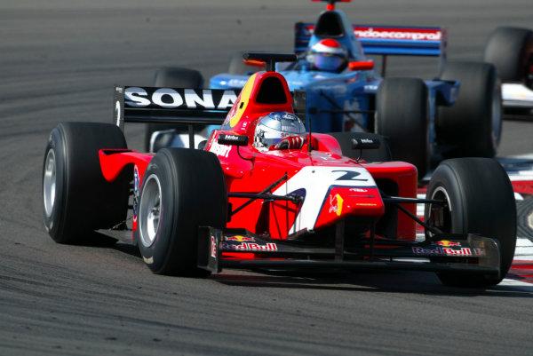 2004 Formula 3000 Championship (F3000) Nurburgring, Germany.29th May 2004. Robert Doornbos (Arden International) leads Yannick Schroeder (Durango Formula). ActionWorld Copyright: LAT Photographic ref: Digital Image Only