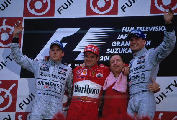 2003 Japanese Grand PrixSuzuka, Japan. 10th - 112th October 2003.Race podium, Rubens Barrichello, Ferrari F2003 GA, (1st), Kimi Raikkonen, Team McLaren Mercedes MP4-17D, (2nd) and David Coulthard, (3rd) are joined on the podium by Jean Todt.World Copyright: Lorenzo Bellanca / LAT Photographic ref: 35mm Image 03JAP27