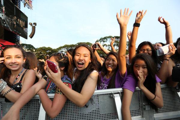 Fans watch Owl City (USA) perform at the Singapore Grand Prix Closing Concert. Singapore Grand Prix Closing Concert, Marina Bay, Singapore, Monday 23 September 2013.