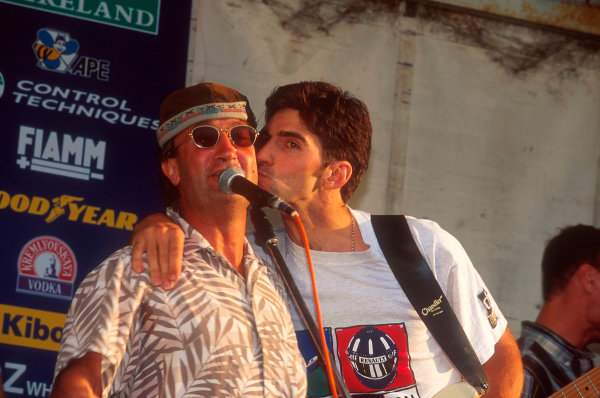 Silverstone, England.14-16 July 1995.Damon Hill shows his boss Eddie Jordan some affection, whilst playing at the Jordan concert.Ref-95 GB 28.World Copyright - LAT Photographic