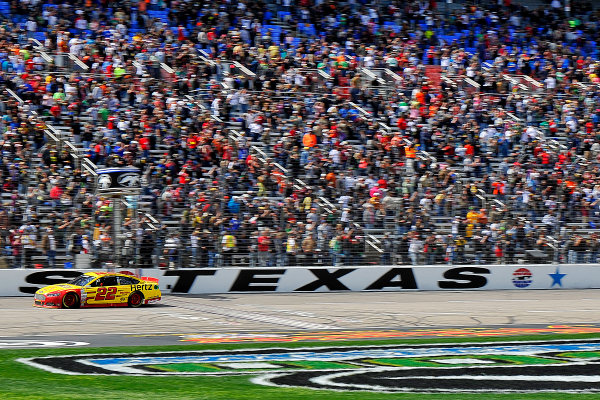 4-6 April, 2014, Fort Worth, Texas USA Joey Logano drives under the checkered flag to win. © 2014, Jennifer Coleman LAT Photo USA