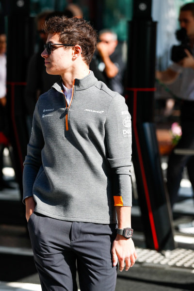 Lando Norris, McLaren, arrives in the paddock