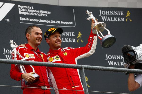 Winner Sebastian Vettel, Ferrari, celebrates on the podium.