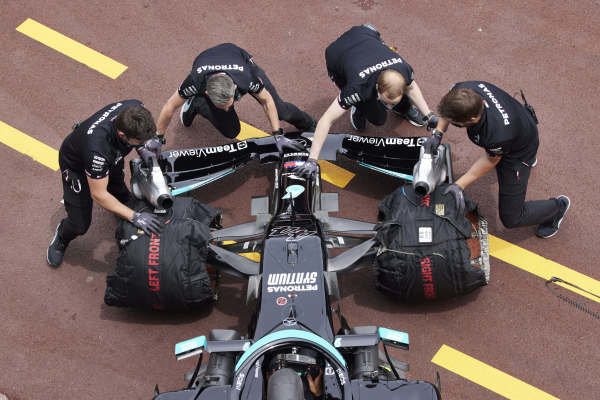 Mechanics return Lewis Hamilton, Mercedes W12, to the garage