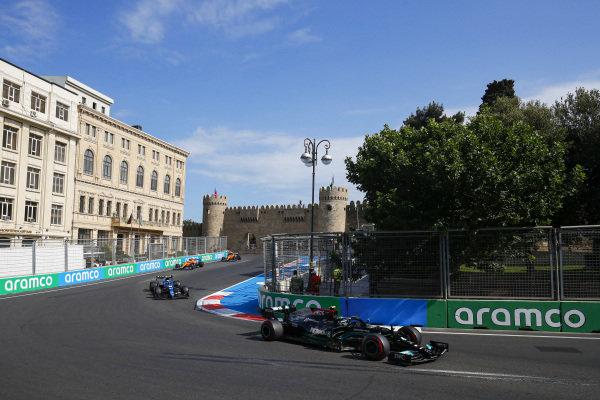 Valtteri Bottas, Mercedes W12, leads Esteban Ocon, Alpine A521, and Lando Norris, McLaren MCL35M