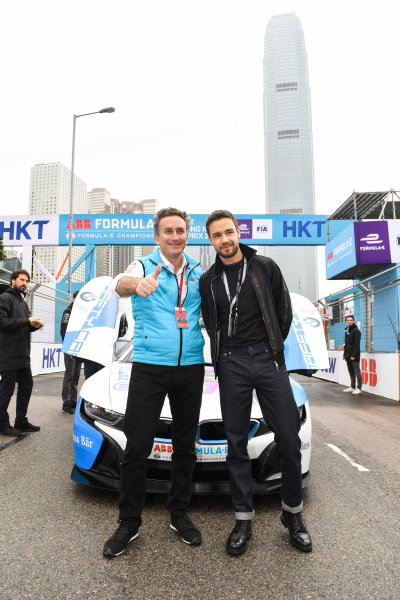 Singer Liam Payne with Alejandro Agag, CEO, Formula E in front of the BMW i8 Safety car