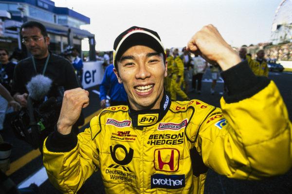 Takuma Sato celebrates his maiden points finish.