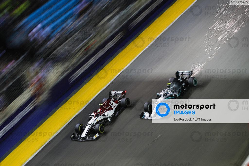 Valtteri Bottas, Mercedes AMG W10, passes Antonio Giovinazzi, Alfa Romeo Racing C38