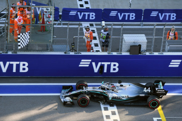 Lewis Hamilton, Mercedes AMG F1 W10, 1st position, takes the chequered flag