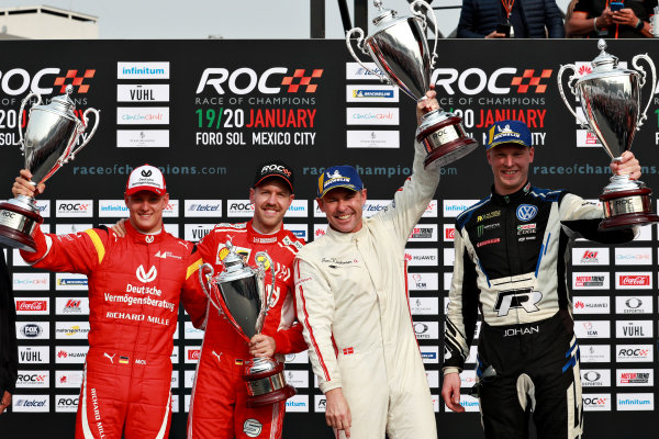 Tom Kristensen (DNK) and Johan Kristoffersson (SWE) of Team Nordic celebrate winning with runners up Sebastian Vettel (GER) and Mick Schumacher (GER) of Team Germany on the podium