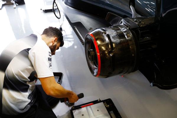 Silverstone, Northamptonshire, UK Thursday 7 July 2016. A McLaren mechanic at work on a McLaren MP4-31 Honda.  World Copyright: Tee/LAT Photographic ref: Digital Image _H7I4321