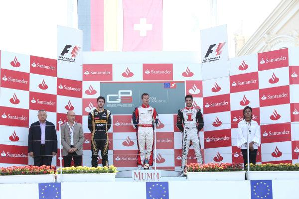2012 GP3 Series, Round 3.Valencia, Spain. 24th June 2012. Sunday Race 2. (LtoR) 2nd place Daniel Abt (GER, Lotus GP) 1st place Patric Niederhauser (SUI, Jenzer Motorsport) 3rd place Tio Ellinas (CYP, Marussia Manor Racing) on the podium. Portrait. World Copyright:  Daniel Kalisz/LAT Photographic Ref: Digital Image IMG_2096