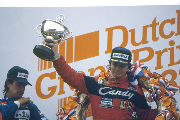 Zandvoort, Holland. 1-3 July 1982. Didier Pironi (Ferrari 126C2), 1st position and Keke Rosberg (Williams FW08-Ford Cosworth), 3rd position on the podium. World Copyright: LAT Photographic Ref: 35mm transparency 82HOL13