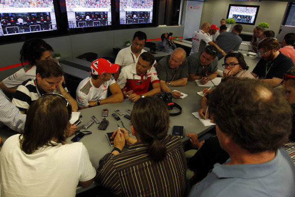 Hungaroring, Budapest, Hungary26th July 2012Jenson Button, McLaren and Lewis Hamilton, McLaren are interviewed by the media.World Copyright:Charles Coates/LAT Photographicref: Digital Image _X5J8943