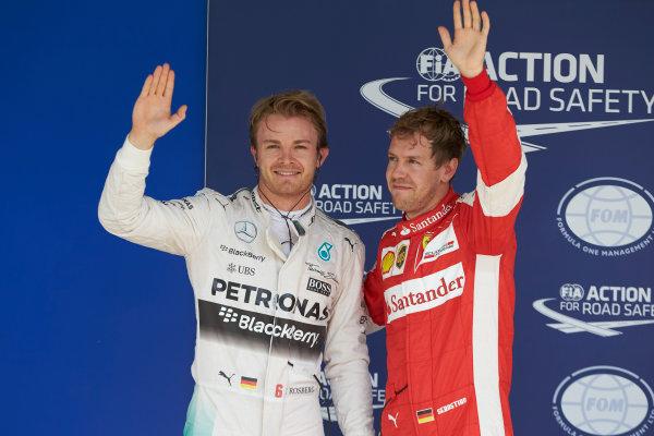 Interlagos, Sao Paulo, Brazil. Saturday 14 November 2015. Pole man Nico Rosberg, Mercedes AMG, with Sebastian Vettel, Ferrari, 3rd on the grid. World Copyright: Steve Etherington/LAT Photographic ref: Digital Image SNE12396