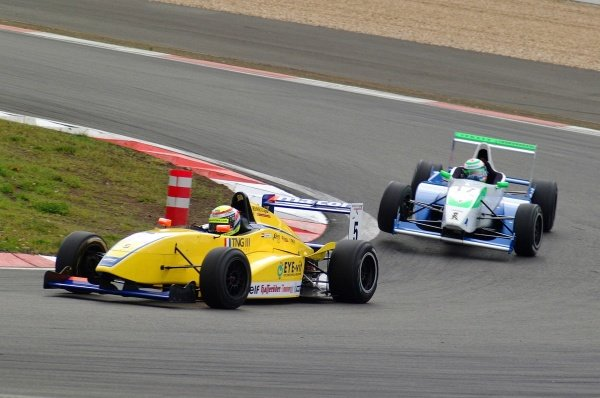 Race 2 winner Ross Zwolsmann (NED) ma-con Racing, leads Bruno Spengler (CAN) Jenzer Motorsport.