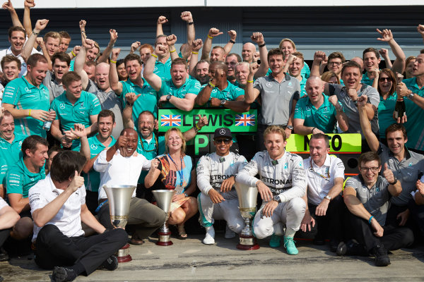 Autodromo Nazionale di Monza, Monza, Italy. Sunday 7 September 2014. Lewis Hamilton, Mercedes AMG, 1st Position, Nico Rosberg, Mercedes AMG, 2nd Position, Hamiltons family and the Mercedes AMG team celebrate victory. World Copyright: Steve Etherington/LAT Photographic. ref: Digital Image SNE15869