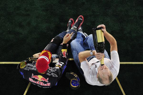 Race winner and 2010 World Champion Sebastian Vettel (GER) Red Bull Racing and Dr Helmut Marko (AUT) Red Bull Motorsport Consultant celebrate on the podium. Formula One World Championship, Rd 19, Abu Dhabi Grand Prix, Race, Yas Marina Circuit, Abu Dhabi, UAE, Sunday 14 November 2010. BEST IMAGE