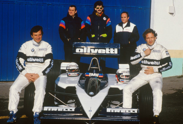 Riccardo Patrese and Elio de Angelis, sit on the tyres of the new Brabham BT55 with Ron Tauranac and Gordon Murray standing behind, portrait. World Copyright: LAT Photographic.Ref: Colour Transparency.