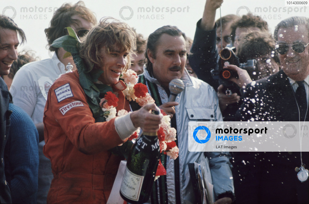 1974 BRDC International Trophy.  Silverstone, England. 7th April 1974.  James Hunt, Hesketh, 1st position, on the podium.  Ref: 74IT02. World Copyright: LAT Photographic